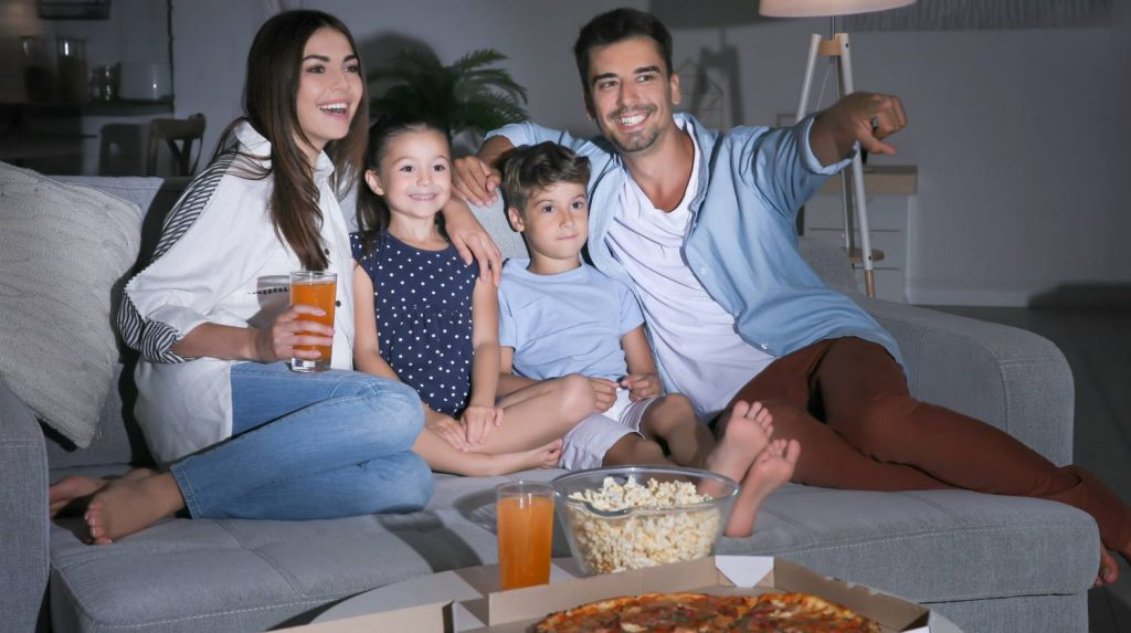 AZURA SMART HOME Happy-family-watching-TV-on-sofa-at-night-movie-night-SS-Featured-1024x573 Azura Solutions